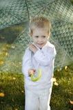 Kid with umbrella. In autumn Stock Photos