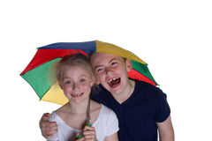 Kid with umbrella. With white background; shot in studio Stock Photos