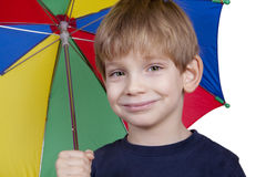 Kid with an umbrella Stock Photos