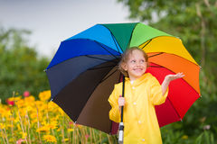 Kid with umbrella Stock Photography