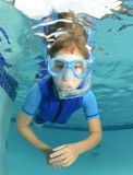 Kid underwater in pool Royalty Free Stock Photo