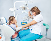 Kid unwilling to show her teeth. In the dentist's room Stock Photography