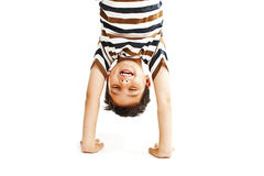 A kid upside down smiling to the camera Stock Photo