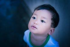 Kid upturned Stock Images