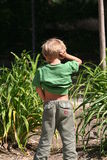 Kid urinating Stock Photo