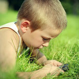 Kid use the Cellphone Royalty Free Stock Image