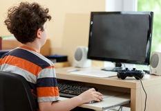 Kid using computer stock photo