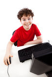 Kid using computer isolated on white background Stock Images