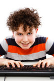 Kid using computer isolated on white background Royalty Free Stock Photo