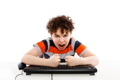 Kid using computer isolated on white background Royalty Free Stock Images