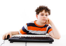 Kid using computer on white background Royalty Free Stock Images