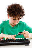 Kid using credit card shopping on-line Stock Photo