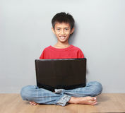Kid using laptop Stock Photography