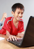 Kid using laptop Stock Image