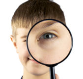 Kid using magnifying glass Stock Photography