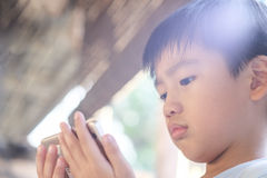Kid using mobile phone Stock Photos