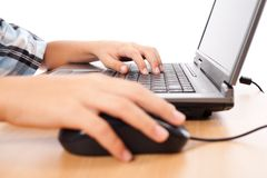 Kid using mouse and keyboard Stock Photo