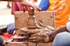 Kid using Potters Wheel Royalty Free Stock Photography
