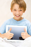 Kid using tablet computer Royalty Free Stock Image