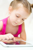 Kid using tablet computer Stock Image