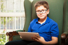 Kid using a tablet computer Royalty Free Stock Photography