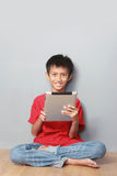 Kid using tablet Royalty Free Stock Photo