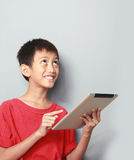 Kid using tablet Stock Photos