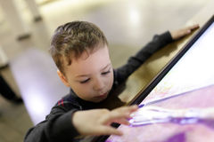 Kid using touch screen Stock Photography