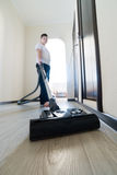 Kid using vacuum cleaner in  house Royalty Free Stock Images