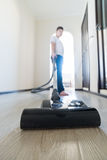Kid using vacuum cleaner in  house Stock Photography