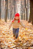 Kid in velvet jacket, jeans, and the red hat Stock Images