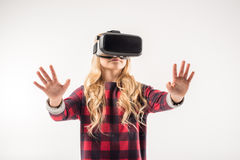 Kid in virtual reality headset. Standing on grey Royalty Free Stock Image