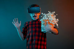 Kid with VR headset and popcorn Royalty Free Stock Photo