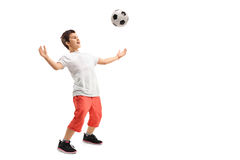 Kid waiting a football on his chest Stock Photo