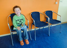 Kid in waiting room. Happy smiling boy (4) sitting in a dentist waiting room Stock Images