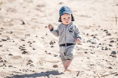 Kid walking on sand stock photo