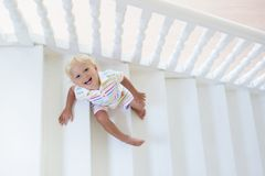 Kids on stairs. Child moving into new home. Stock Photos