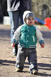 Kid walks from mother Royalty Free Stock Image