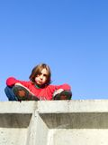 Kid on a wall royalty free stock photography