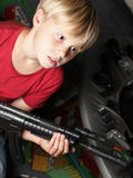 Kid warrior, soldier, shooting Royalty Free Stock Photos