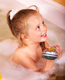 Kid washing in bath. Royalty Free Stock Photo