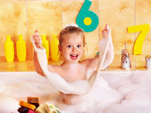 Kid washing in bath. Stock Photo