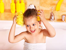 Kid washing in bath. Stock Images