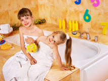 Kid washing in bath. Stock Photos