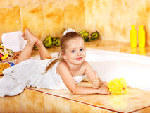 Kid washing in bath. Stock Image