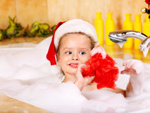Kid washing in bath. Stock Photography