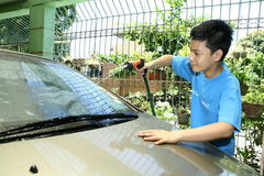 Kid Washing A Car Royalty Free Stock Photography