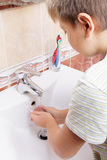 Kid washing hands Stock Photo