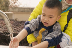 Kid washing hands Royalty Free Stock Photography