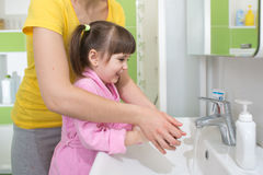 Kid washing hands with mom Royalty Free Stock Images